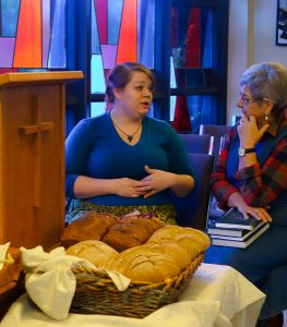Annika Krause talking to Laura Eriksson at PGIMF with the bread she baked